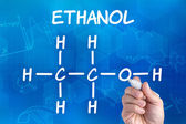 Hand with pen drawing the chemical formula of ethanol — Stock Photo