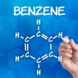 Hand with pen drawing the chemical formula of benzene — Stock Photo #29120721