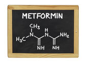Chemical formula of metformin on a blackboard — Stock Photo