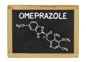 Chemical formula of omeprazole on a blackboard — Stock Photo