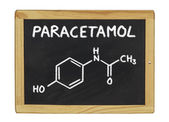 Chemical formula of paracetamol on a blackboard — Stock Photo
