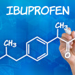 Hand with pen drawing the chemical formula of ibuprofen — Stock Photo