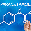 Hand with pen drawing chemical formulof paracetamol — Stock Photo #32047495