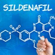 Hand with pen drawing the chemical formula of sildenafil — Stock Photo