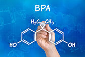 Hand with pen drawing the chemical formula of BPA — Stock Photo