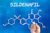 Hand met pen tekening de chemische formule van sildenafil — Stockfoto