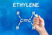 Hand with pen drawing the chemical formula of ethylene — Stock Photo