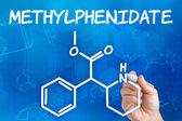 De la mano con pluma de dibujo de la fórmula química del metilfenidato — Foto de Stock
