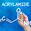 Stock Photo: Hand with pen drawing chemical formulof acrylamide
