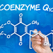 Hand with pen drawing the chemical formula of coenzyme Q10 — Stock Photo