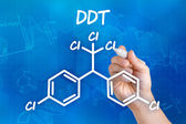 Hand with pen drawing the chemical formula of DDT — Stok fotoğraf