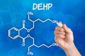 Hand with pen drawing the chemical formula of DEHP — Stockfoto