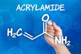 De la mano con pluma de dibujo de la fórmula química de acrilamida — Foto de Stock