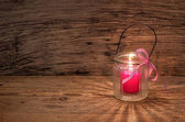 Candle on a wooden background — Stock Photo