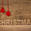 The word christmas in front of a rustic background — Stock Photo