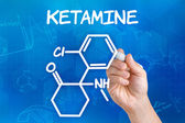 Hand with pen drawing the chemical formula of ketamine — 图库照片