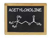 Chemical formula of acetylcholine on a blackboard — Stock Photo