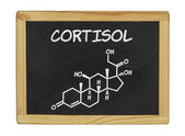 Chemical formula of cortisol on a blackboard — Stockfoto