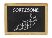 Chemical formula of cortisone on a blackboard — Stock Photo