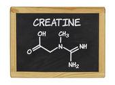 Chemical formula of creatine on a blackboard — Stock Photo