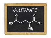 Chemical formula of glutamate on a blackboard — Stockfoto