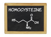 Chemical formula of homocystein on a blackboard — Stock Photo