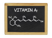 Chemical formula of vitamin a on a blackboard — Stock Photo