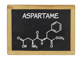 Chemical formula of aspartame on a blackboard — Zdjęcie stockowe