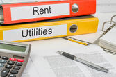 Folders with the label Rent and Utilities — Stock Photo