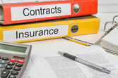 Folders with the label Contracts and Insurance — Stock Photo