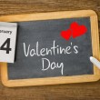Stock Photo: Calendar and blackboard showing February 14, Valentine's day