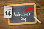 Calendar and blackboard showing February 14, Valentine's day — Stock Photo