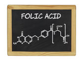 Chemical formula of folic acid on a blackboard — Stok fotoğraf