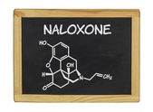 Chemical formula of naloxone on a blackboard — Stock Photo