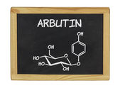 Chemical formula of arbutin on a blackboard — Stock Photo