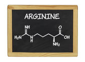 Chemical formula of arginine on a blackboard — Stock Photo