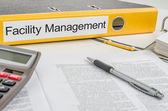 Folder with the label Facility Management — Stock Photo