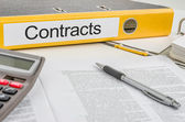 Folder with the label Contracts — Stock Photo