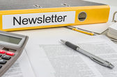 Folder with the label Newsletter — Stock Photo