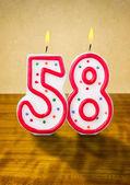 Burning birthday candle — Stock Photo