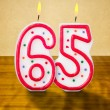 Burning birthday candles number 65 — Stock Photo #42523685