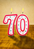 Burning birthday candles number 70 — Stock Photo