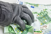 Thief with leather glove is grabbing some bills — Stock fotografie