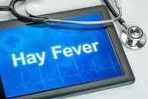 Tablet with the diagnosis hay fever on the display — Stock Photo
