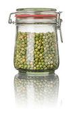 Green peas in a jar — Stock Photo