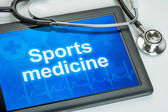 Tablet with the text Sports medicine on the display — Stock Photo