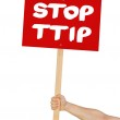 Person holding a sign saying Stop TTIP — Stock Photo