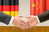 Representatives of Germany and China shake hands — Stock Photo