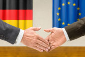 Representatives of Germany and the EU shake hands — Stock Photo