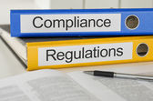 Folders with the label Compliance and Regulations — Stock Photo